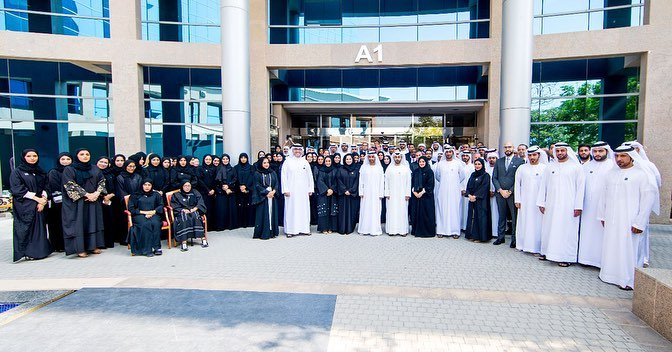 ahmed-bin-humaid-al-nuaimi-listens-to-a-number-of-employees